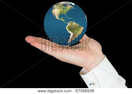 Hand presenting against earth