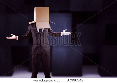 Anonymous businessman with hands out against abstract black room