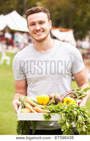 Man With Fresh Produce Bought At Outdoor Farmers Market