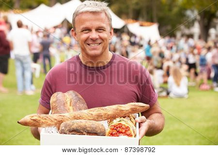 Man With Fresh Bread Bought At Outdoor Farmers Market
