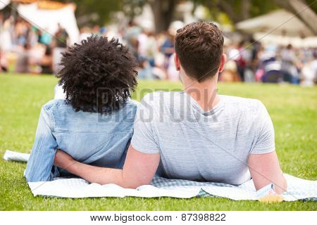 Rear View Of Couple Relaxing At Outdoor Summer Event