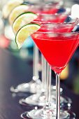 picture of cosmopolitan  - Four Cosmopolitan cocktails shot on a bar counter - JPG