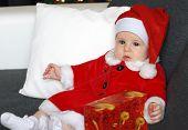 foto of santa baby  - Little baby wearing a Santa - JPG