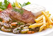 stock photo of pork chop  - Pork Chop with French fries and vegetables - JPG