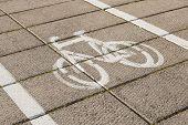 stock photo of bike path  - Bike path with a symbol of bike - JPG