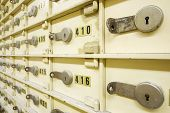 foto of bank vault  - Closeup of a group of cells in an old safe bank - JPG