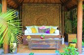 picture of gazebo  - Outdoor sofa and table taken in a garden gazebo - JPG