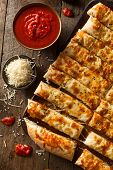 image of dipping  - Homemade Cheesy Breadsticks with Marinara Sauce for Dipping - JPG