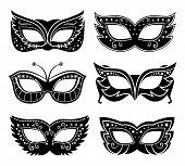 stock photo of masquerade  - Black carnival masks - JPG