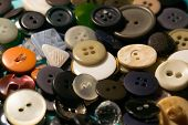 foto of orifice  - the background of a large number of buttons closeup - JPG