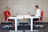 picture of workstation  - business man and woman in correct sitting posture at workstations in the office - JPG