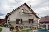pic of insulator  - Construction or repair of the rural house fixing facade insulation and using color for new look - JPG
