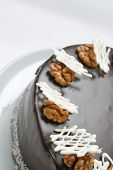 picture of chocolate-chip  - chocolate cake decorated with nuts and white chocolate chips - JPG