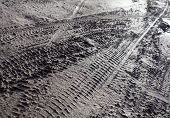 stock photo of dirt road  - Wheel tracks on the dirt road after the rain