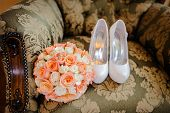 foto of wench  - bridal bouquet and the bride shoes on chair - JPG