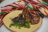 picture of veal  - Grilled organic veal fillet on yellow plate with salad - JPG