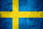 foto of sweden flag  - flag of Sweden or Swedish banner on rough pattern texture background - JPG