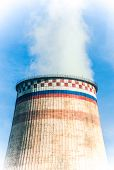 foto of fumes  - fuming classic chimney of the heat station - JPG