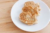 picture of plate fish food  - Japanese confectionery taiyaki fish cake wagashi on plate on table - JPG