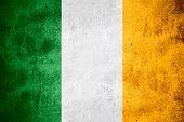 image of irish flag  - flag of Ireland or Irish banner on rough pattern texture background - JPG