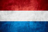 foto of holland flag  - flag of Holland or Dutch banner on rough pattern texture background the Netherlands - JPG