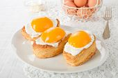 picture of yolk  - Fried eggs cookies with peach yolks on a white plate - JPG