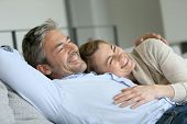 pic of maturity  - Mature couple relaxing in sofa - JPG