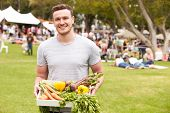 pic of farmers market vegetables  - Man With Fresh Produce Bought At Outdoor Farmers Market - JPG