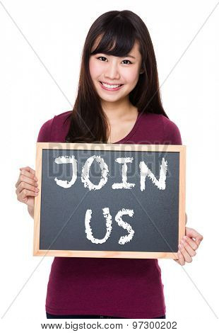 Woman with black board and showing phrase of join us