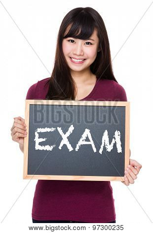 Woman with black board and showing a word exam