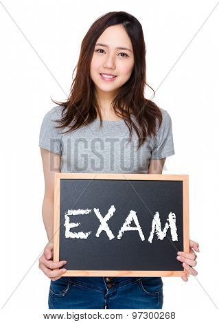 Woman hand hold with blackboard and showing a word exam