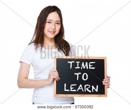 Young woman hold with blackboard showing phrase of time to learn