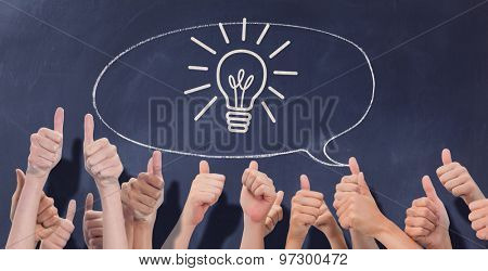 Group of hands giving thumbs up against speech bubble on chalkboard