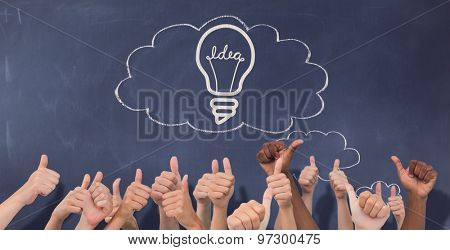 Hands giving thumbs up against thought clouds on chalkboard