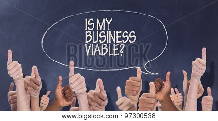Hands showing thumbs up against speech bubble on chalkboard