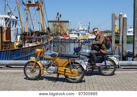 Man sitting on a vintage Zundapp motorbike
