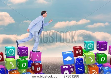 Stepping businessman against desert landscape with blue sky