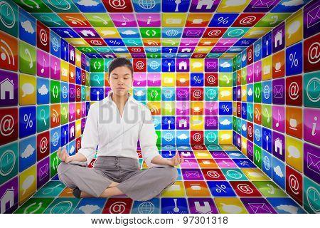 Businesswoman sitting in lotus pose against app room