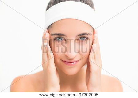 Close up of a beautiful young woman over white background