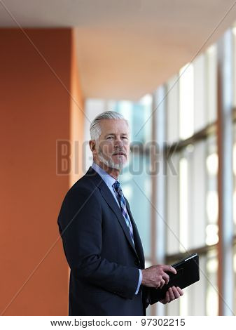 senior business man working on tablet computer at office