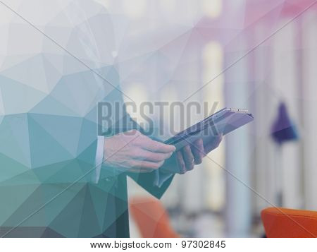 Double exposure design. Senior business man working on tablet computer at office