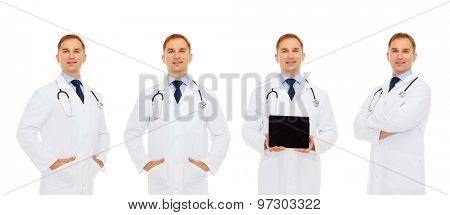 medicine, profession, technology and health care concept - happy doctors with tablet pc computer and stethoscope