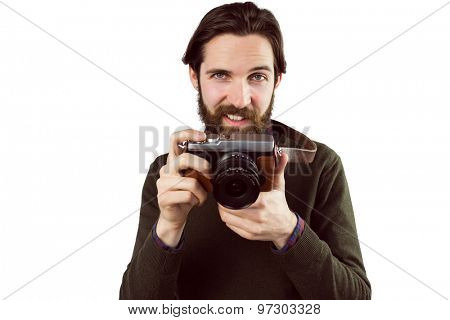 Hipster using his vintage camera on white background