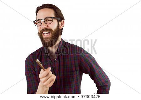 Handsome hipster laughing and pointing on white background