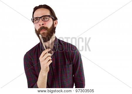 Handsome hipster thinking and holding pen on white background