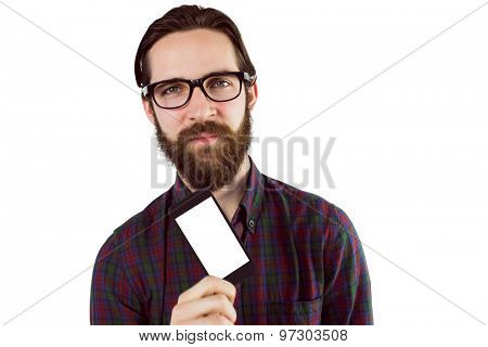 Handsome hipster showing his phone on white background