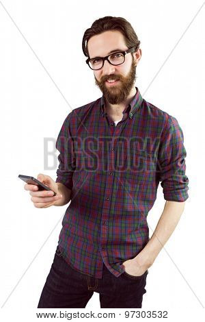 Handsome hipster using his phone on white background