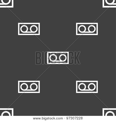 Audio Cassette Icon Sign. Seamless Pattern On A Gray Background. Vector