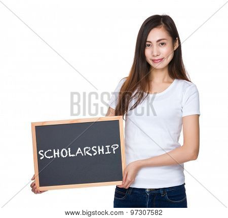 Young lady hold with blackboard showing a word scholarship