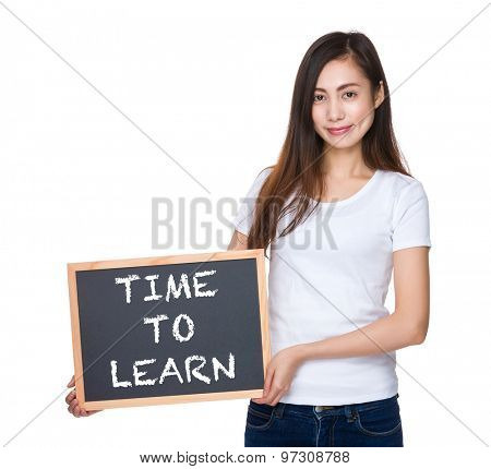 Young lady hold with blackboard showing phrase of time to learn